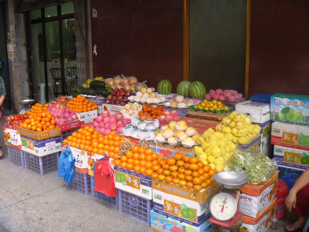A sidewalk fruit stall