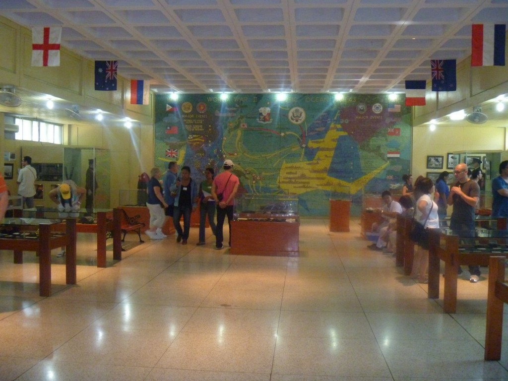 The museum interior with mural in background