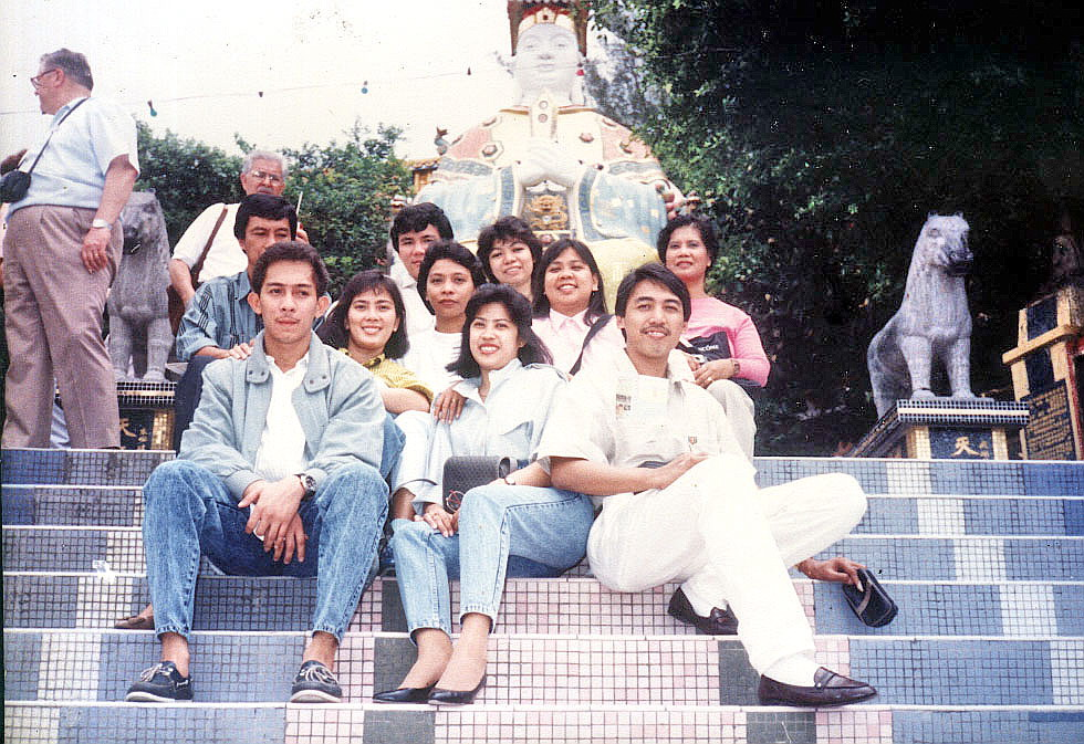 Posing in front of the statue of Kwan Yam