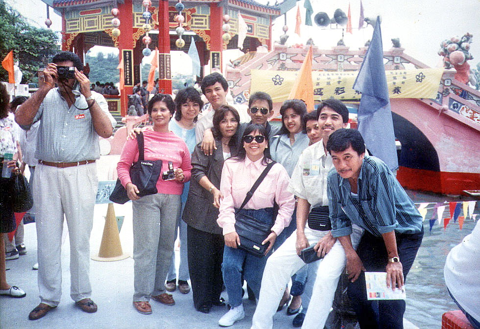 Posing in front of the Kwun Yam Shrine and Longevity Bridge