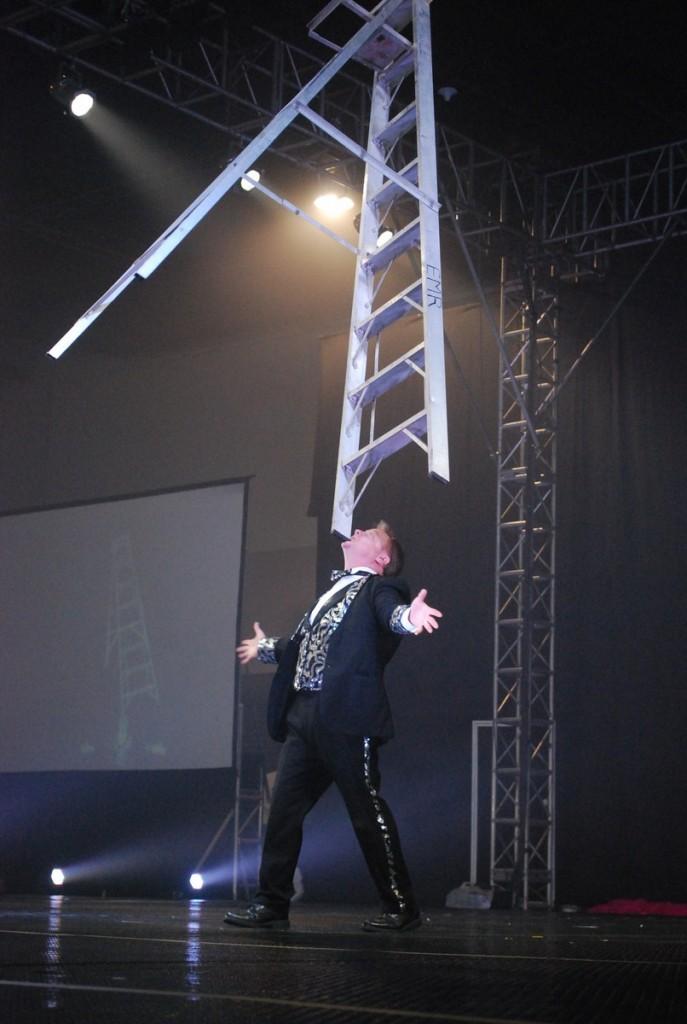 Host Jon Weiss balancing a step ladder