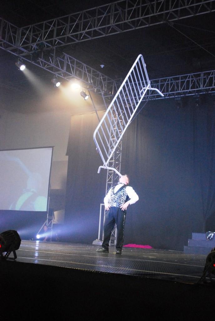 Host Jon Weiss balancing a heavy steel barrier