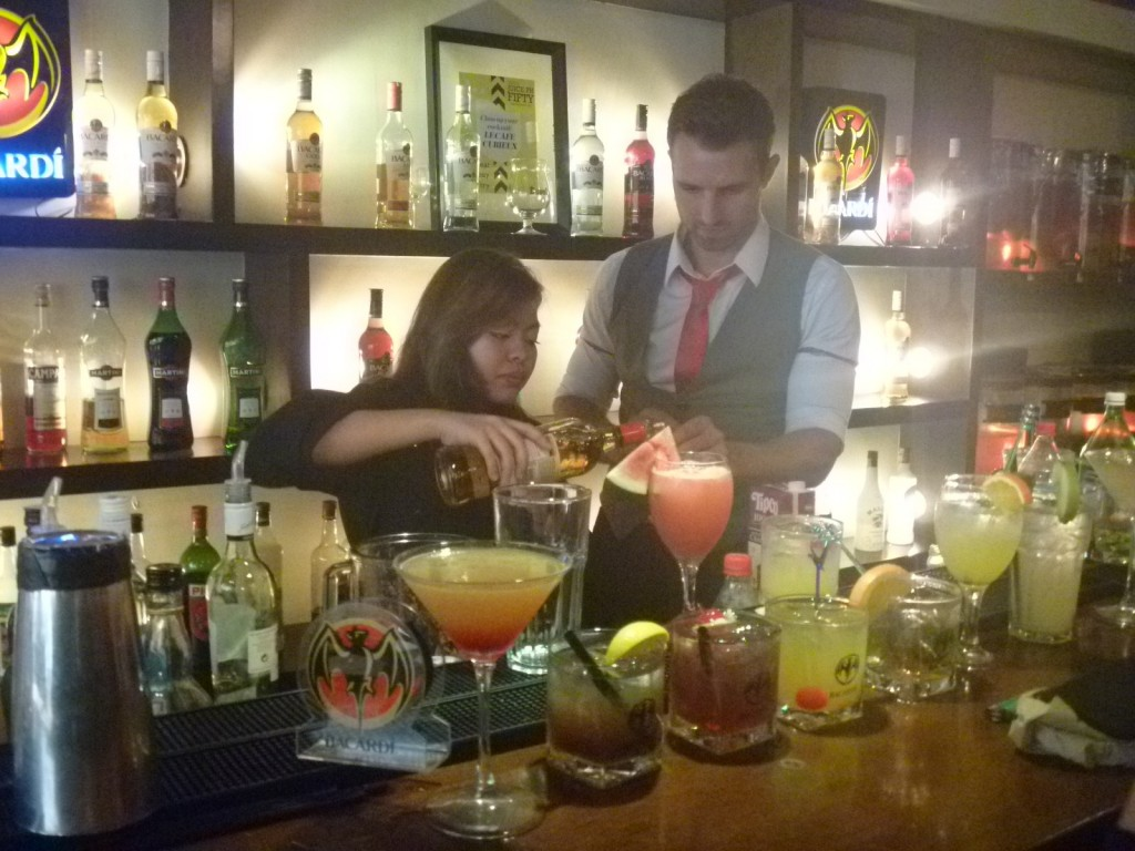 Anthony assisting a participant preparing a cocktail