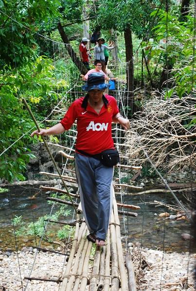 Crossing a swinging bridge on the return trek