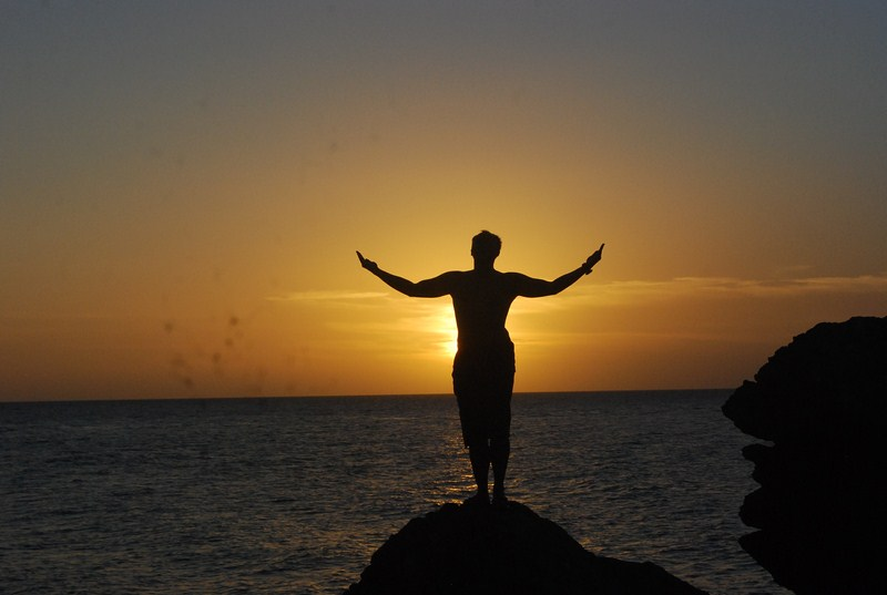 Flord in a U.P. Oblation pose, sihouetted against the setting sun