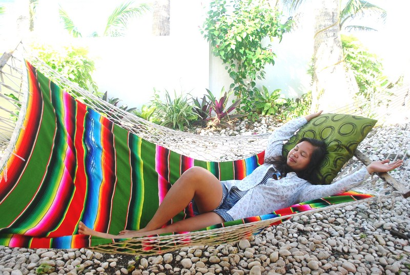 Regine tries out the cozy and colorful hammock