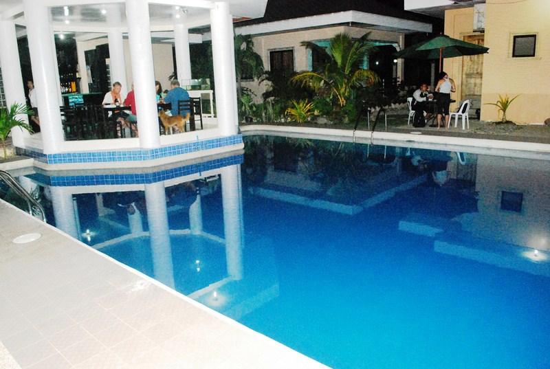 The resort's swimming pool and poolside gazebo bar