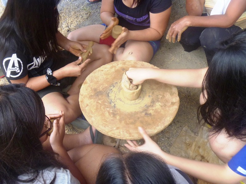The students try their hand at pottery making