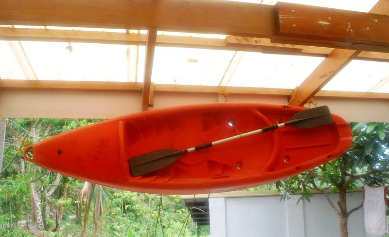 A damaged kayak left hanging by the booth