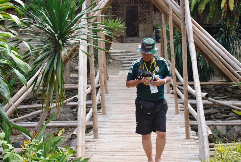 Author crossing bamboo bridge (photo: Sheena Ferrer)