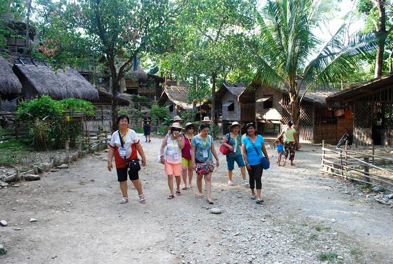 Oriental Mindoro Cruise Drive Caravan ladies exploring village