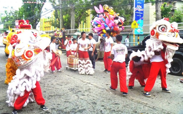 Lion dancers from the Fil-Chinese community