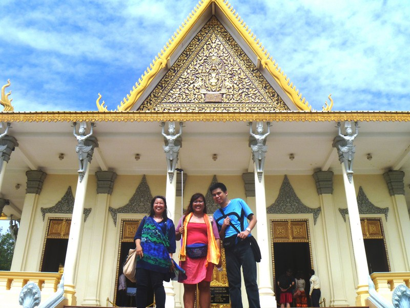 Osang, Violet and Jandy at top of grand stairway