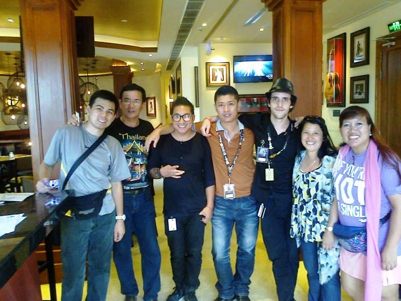Posing with Hard Rock Cafe management and staff