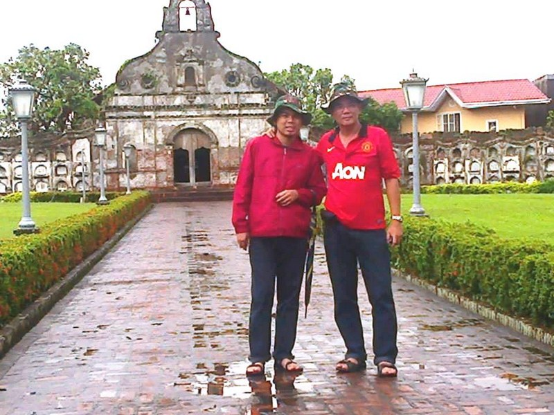 Father and son in front of the chapel