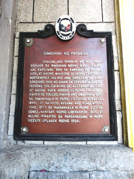 Plaque detailing the history of the church
