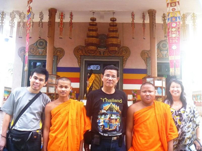 Posing with some monks in the temple