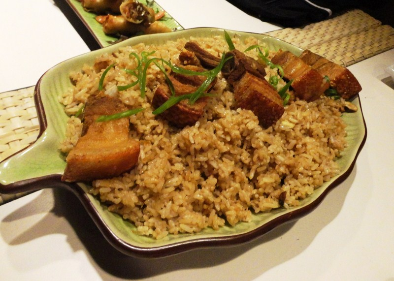 Fried rice topped with slices of lechon kawali