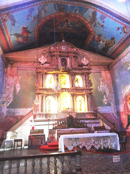 The main altar with its painted ceiling