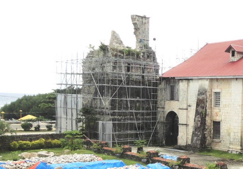 The collapsed bell tower surrounded by scaffolds
