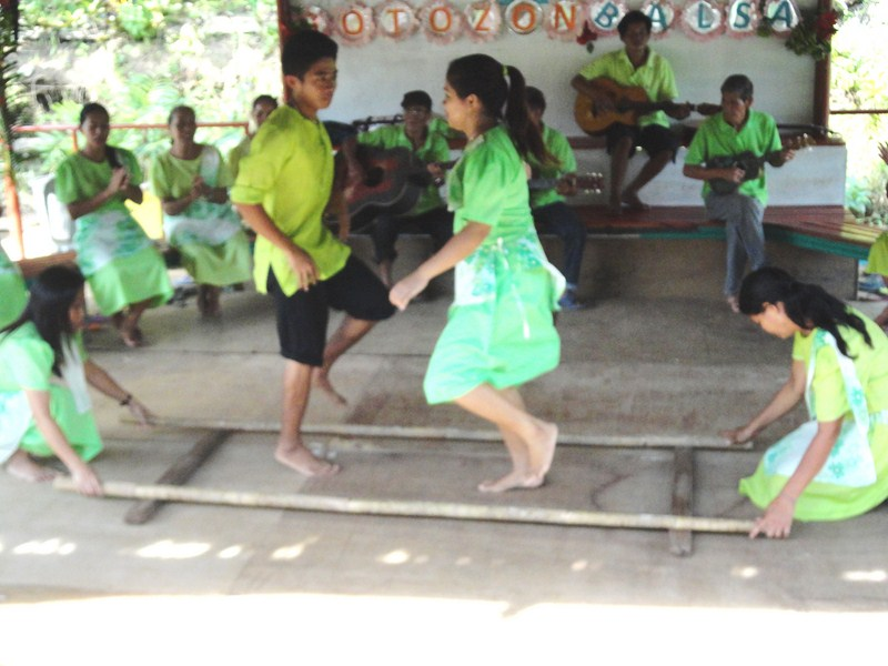 Tinikling dancers in action