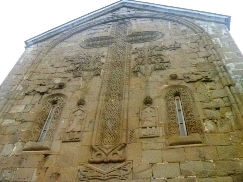 Grapevine cross carved on the south façade of the church