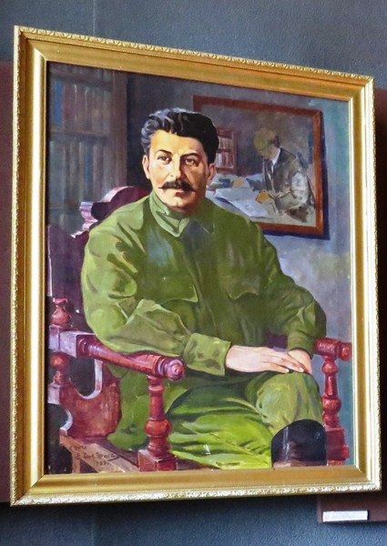 Portrait of a sitting Stalin