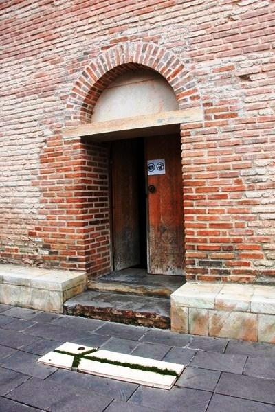 A grave beside a side entrance