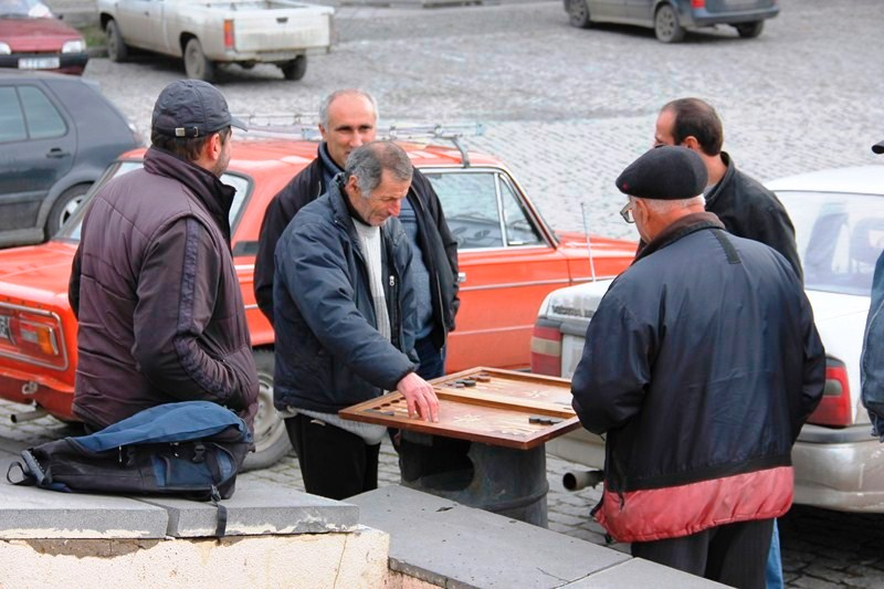 Georgian men playing backgammon in the open