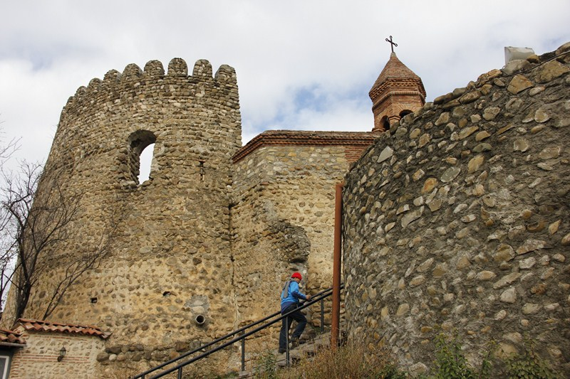 The author exploring part of Sighnaghi's defensive wall and towers