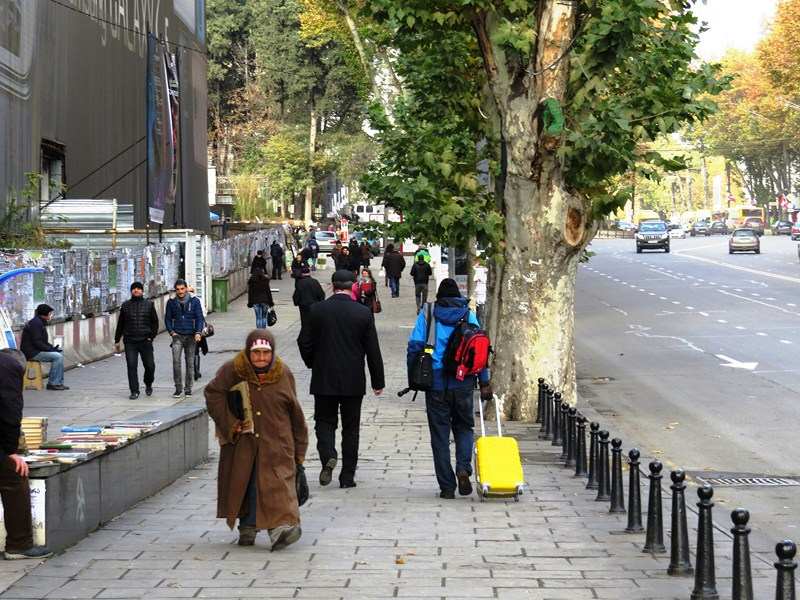 The author (in blue jacket) walking among sea of Georgians all in dark-colored jackets