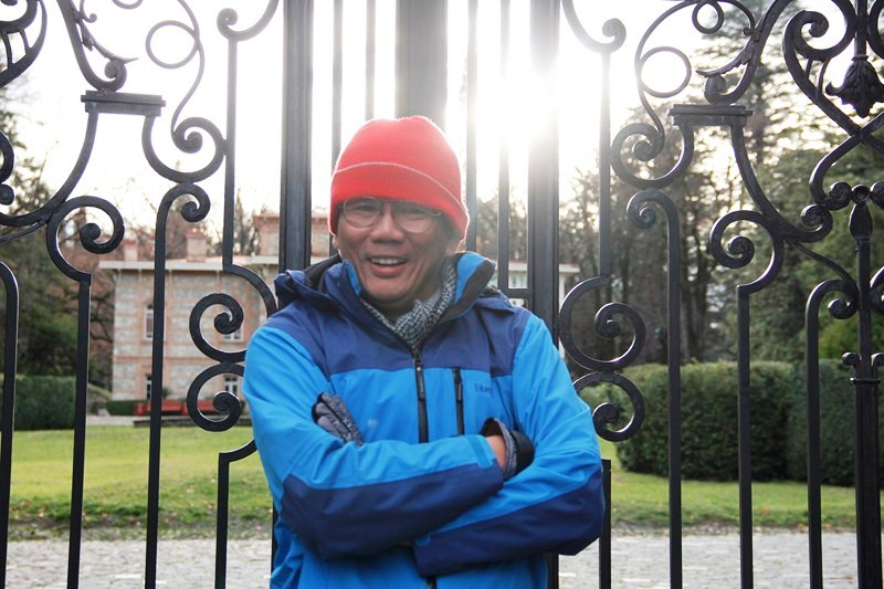 The author waiting outside the manor's iron gate (photo - Ms. Riva Galvestan)