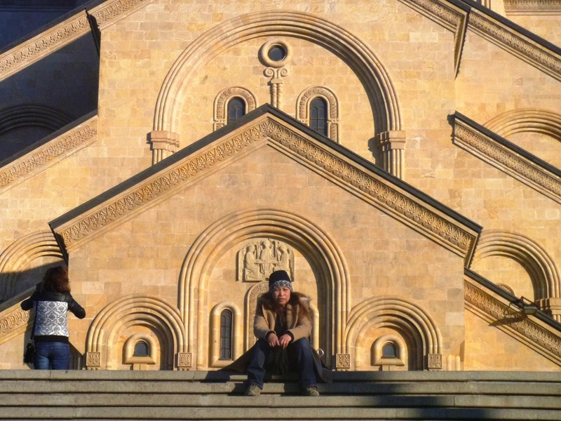 Ruby sitting at the steps leading to the cathedral