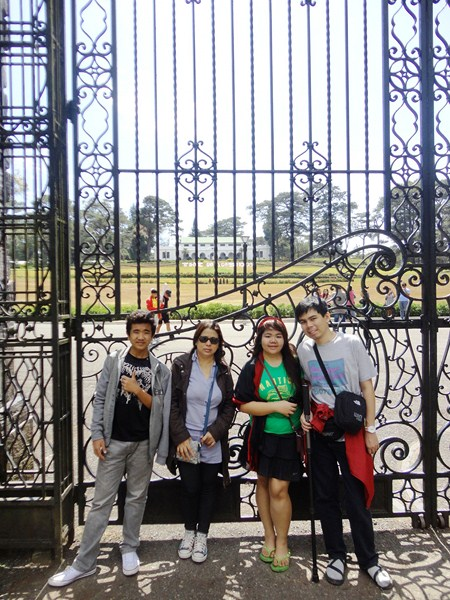 Albert, Melissa, Almira and Jandy posing in front of the gate