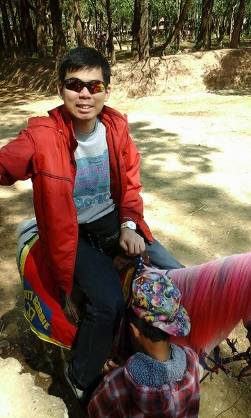 Jandy riding a pink-maned horse