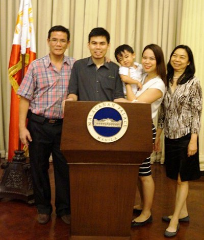 My family at the podium, carrying the official seal, which the President uses when he rehearses for the SONA (State of the Nation Address).