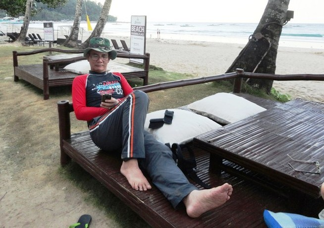The author relaxing by the beach