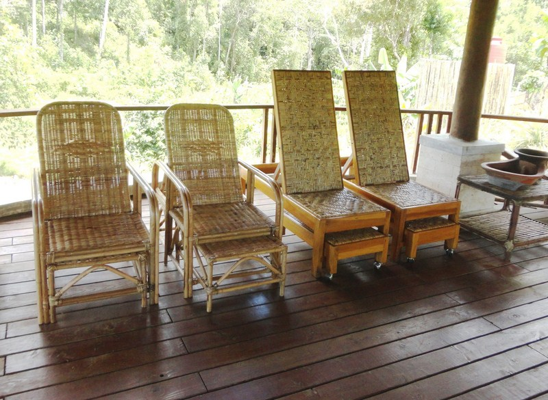 Comfortable rattan loungers at the gazebo