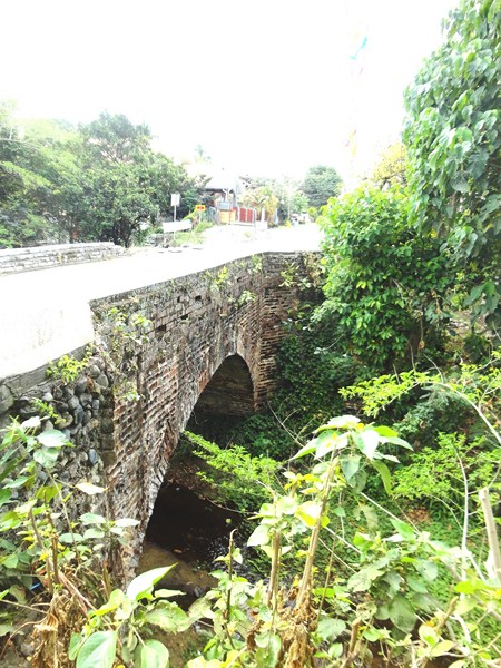 The nearly two century old, single arch Dampol Bridge