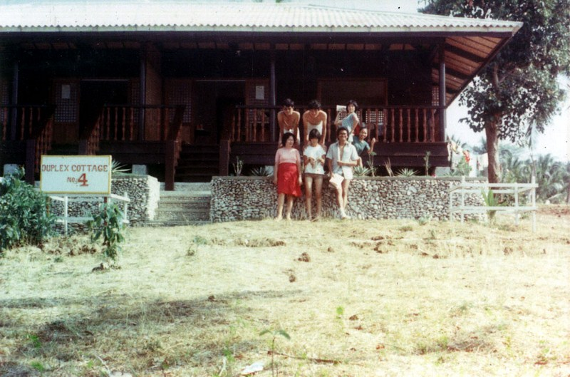 Posing beside one of Interlink Resort's duplex cottages