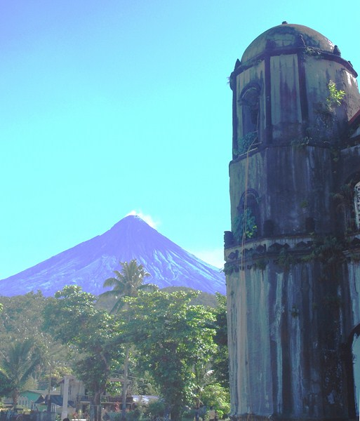 The bell tower with Mt. Mayon on its left