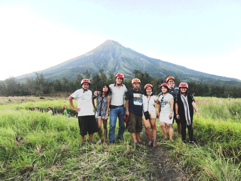 The media group with the now cloud-free Mt. Mayon in the background