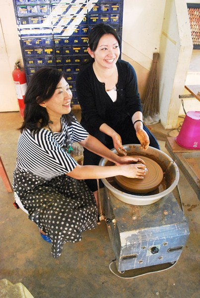 Yukiko and Chiaki at the potters wheel