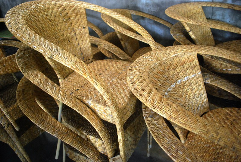 A stack of finished rattan chairs