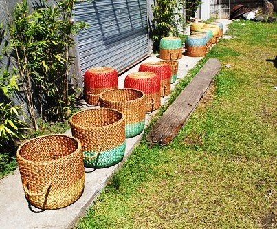 Newly painted baskets are placed under the sun to dry