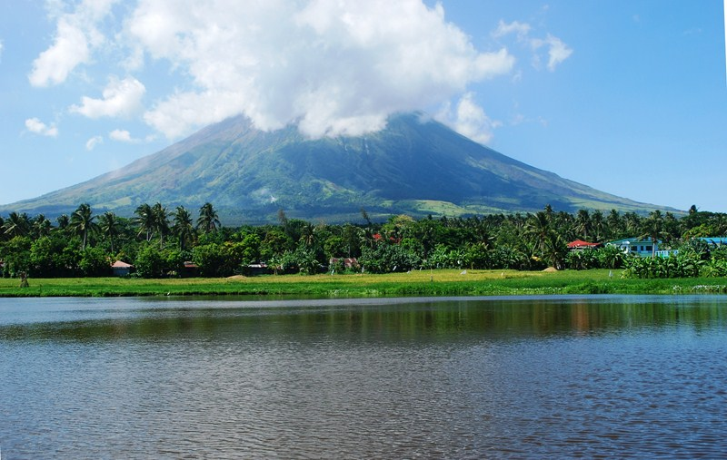 Sumlang Lake with the partly cloud-shrouded Mt. Mayon in the background