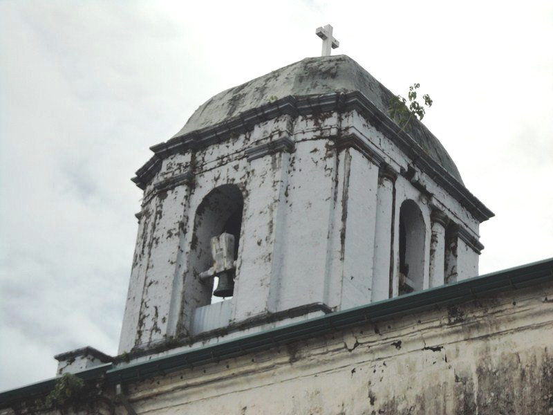 The centrally located square bell tower