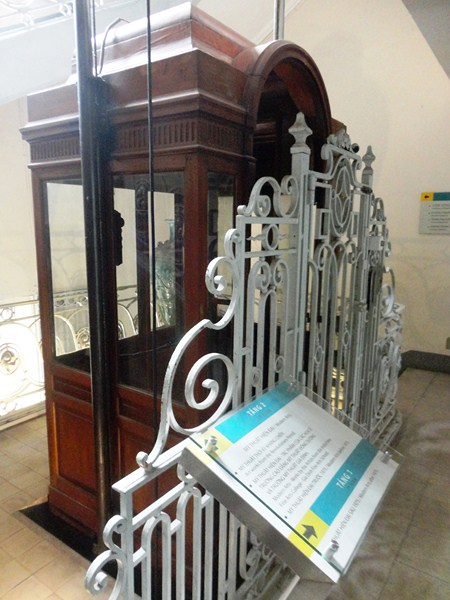 An antique wooden lift