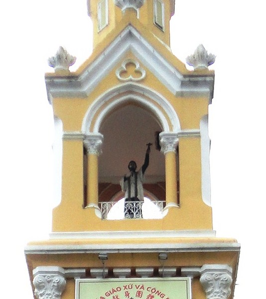 Statue of Fr. François Xavier Tam Assou at the church steeple