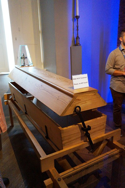 Reusable coffin at Room 7 - In the Name of Reason
